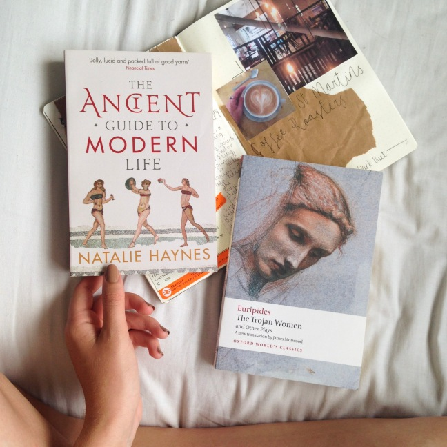 Flat lay, crossed legged showing two of my favourite books of 2018 so far - The Ancient Guide to Modern Life by Natalie Haynes and The Trojan Women by Euripides