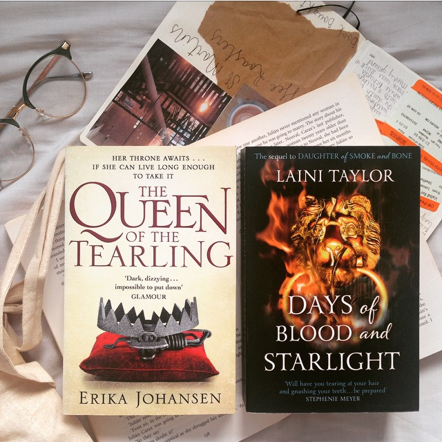 The Queen of the Tearling by Erika Johansen and Days of Blood and Starlight by Laini Taylor