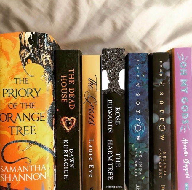 collection of books - the priory of the orange tree by samantha shannon, the dead house by dawn kurtagich, the graces by laure eve, the harm tree by rose edwards, state of sorrow and song of sorrow by melinda salisbury, oh my gods by alexandra sheppard